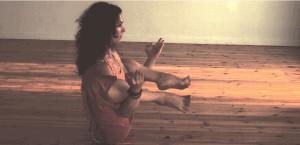 balancing both legs on arms